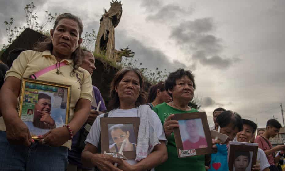 Relatives and friends of victims of the Philippines's war on drugs protesting in Manila in 2017.