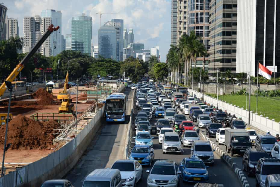 Motionless in macet: Gridlocked cars as work continues on Jakarta's metro system.