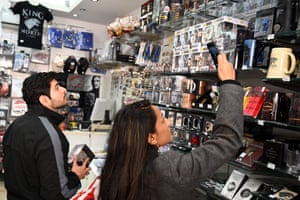 Visitors looks at gifts in a Game of Thrones shop