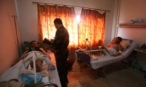 """Syrian men who escaped an attack by Islamist fighters on a medical facility, in hospital in Latakia, the coastal city controlled by the Assad regime. Al-Nusra Front and other Islamist factions took control of a hospital complex in Jisr al-Shughur last week but official Syrian state media said the army had successfully """"broken the siege"""" on the hospital allowing regime forces to reach safety."""