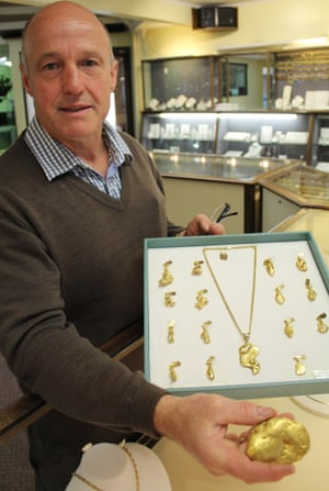 Barry Rooney, owner of The Gold Room in Hokitika, New Zealand, with local West Coast nuggets. Photo: Eleanor Ainge Roy for The Guardian