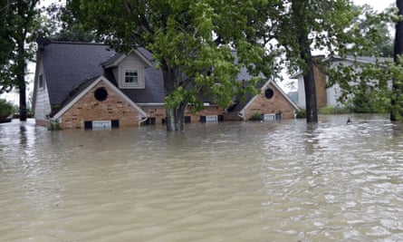 A home is surrounded by floodwaters from Hurricane Harvey in Spring, Texas.