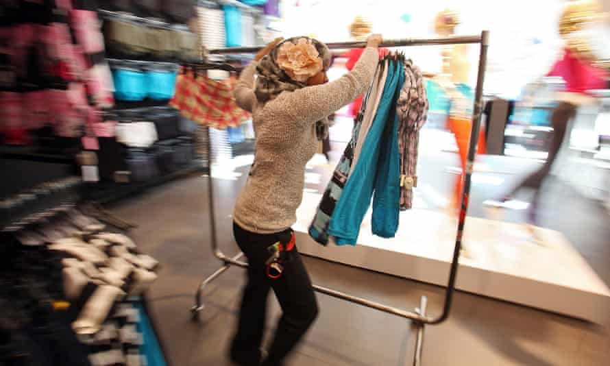 An H&M store: critics say cheap clothes means there is a risk people buy and throw away or buy too much.