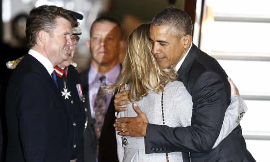Obama is greeted by the US ambassador to Britain, Matthew Barzun, and his wife, Brooke, on his arrival.