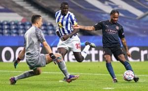 Porto goalkeeper Agustin Marchesin denies Raheem Sterling.