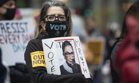 Ruth Novak holds a sign at Federal Plaza in Chicago.