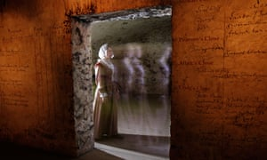 The ghostly figure of a woman seen in a doorway in The Real Mary King's Close tourist attraction, Edinburgh, Scotland.