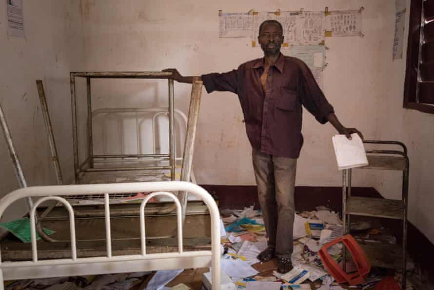 Hospital lab technician Leon Bambeteba stands amid rubbish at a hospital that was looted during an attack on Gambo in which dozens of civilians were killed