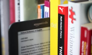 Amazon Kindle next to books