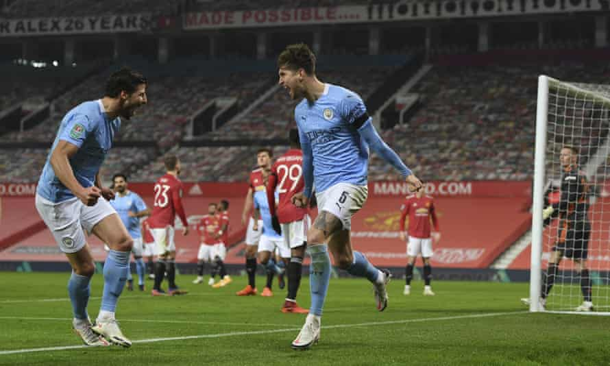 John Stones, right, celebrates scoring the opening goal of Manchester City's Carabao Cup semi-final victory over Manchester United.