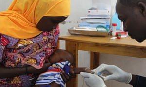 An eight-week old baby is vaccinated against eight antigens, including hepatitis B at the Madarounfa health centre in Niger.