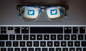 twitter logo in glasses