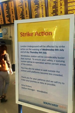 A strike action sign inside Wimbledon railway station