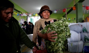 A coca grower holds coca leaves at a market in La Paz, Bolivia.