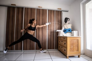 German épée fencer Alexandra Ndolo trains with a self-made dummy fighter in her apartment in Cologne, Germany.
