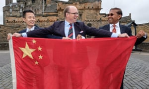 Brig David Allfrey (centre), CEO of Royal Edinburgh Military Tattoo, with Austin Xu and Sudhir Taparia of WeChat Pay, the Chinese online payment system.
