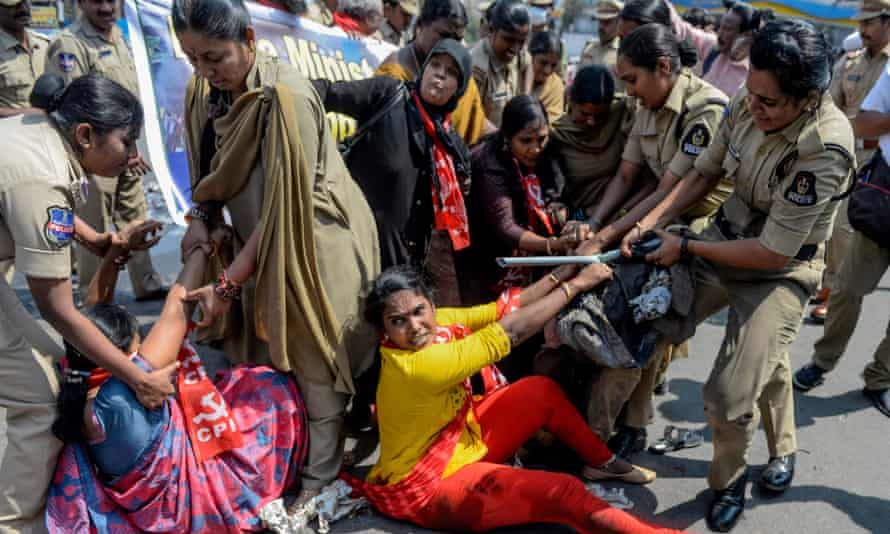 Police attempt to arrest protesters in Hydrabad after the protests in Delhi