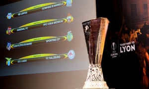 The match fixtures are displayed on an electronic panel next to the Europa League trophy following quarter final draw.