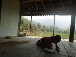 Child does homework in Sirthauli, Sindhuli, Nepal
