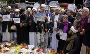 Religious leaders gather to visit the scene of Saturday's attack