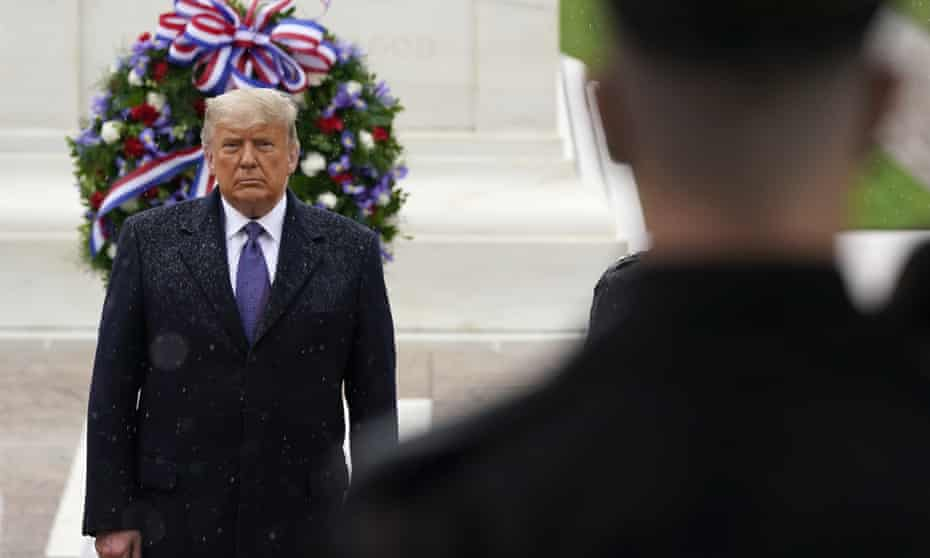 Donald Trump participates in a Veterans Day observance at Arlington national cemetery in Virginia on 11 November.