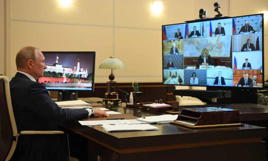 Vladimir Putin during a video conference with Russian government officials.