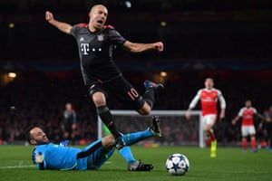 Bayern Munich's Arjen Robben is tackled by Arsenal keeper David Ospina.