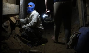 A Palestinian youth works inside a smuggling tunnel beneath the Egyptian-Gaza border in 2013. Most of these tunnels have since been destroyed by the Egyptian army.