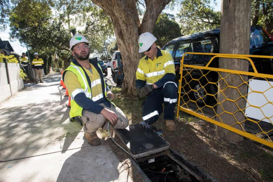 Contractors working with the rollout of the NBN network.
