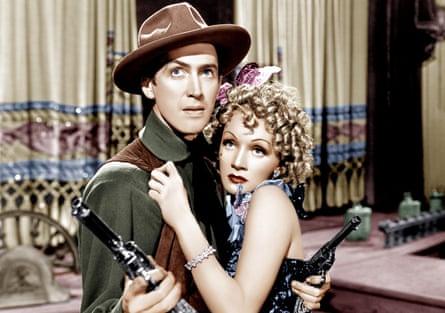 Marlene Dietrich with James Stewart in Destry Rides Again (1939).