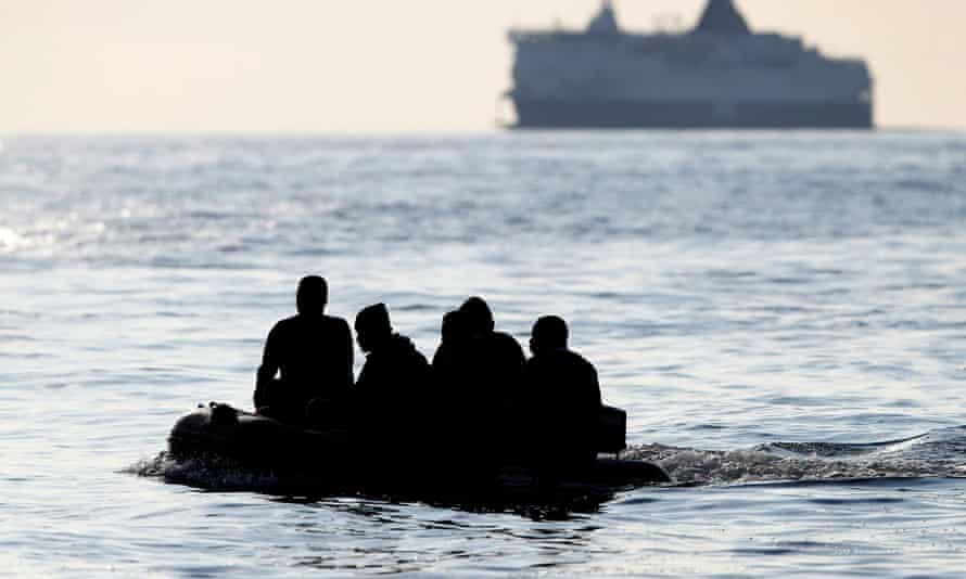 Migrants claiming to be from Darfur, Sudan crossing the Channel in an inflatable boat near Dover.