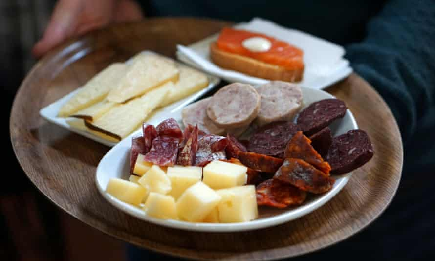 A plate of cured meats and ham to promote Devour Barcelona's Catalan countryside day trip for food fans.