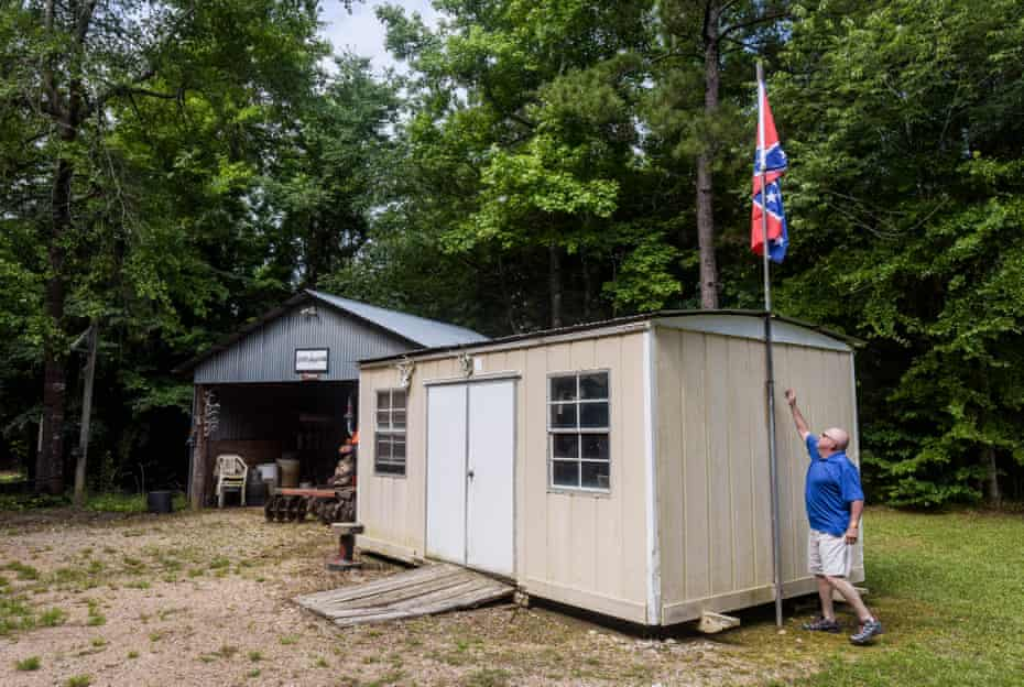 Ira Isonhood adjusts the flag pole in the backyard of his home in Copiah County, Mississippi.