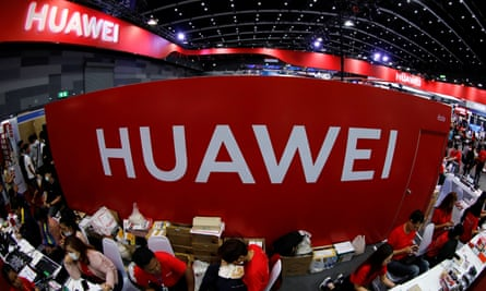 Workers sit at a Huawei stand at an Expo in Bangkok, Thailand.