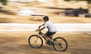 A boy riding a bike