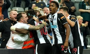 Newcastle fans celebrate with Allan Saint-Maximin after he got them back on level terms.