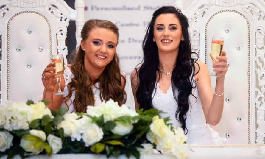Robyn Peoples (left) and Sharni Edwards make a toast during their wedding in Loughshore hotel in Carrickfergus.