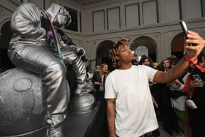 New York, US. Juice WRLD poses with a sculpture of himself at Spotify's RapCaviar Pantheon at Brooklyn Museum