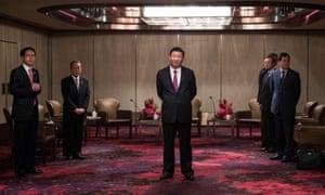 Chinese president Xi Jinping  waits to meet Hong Kong chief executive Leung Chun-ying at a hotel in the semi-autonomous city on Thursday.