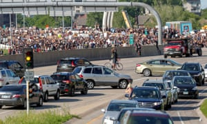 Protesters block all lanes of Interstate 35W during a protest against the death in Minneapolis police custody of George Floyd, in Minneapolis, Minnesota