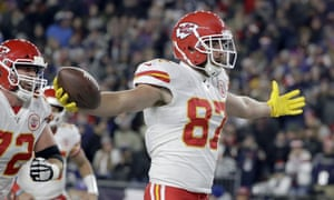 Travis Kelce celebrates his touchdown in the first half against the Patriots