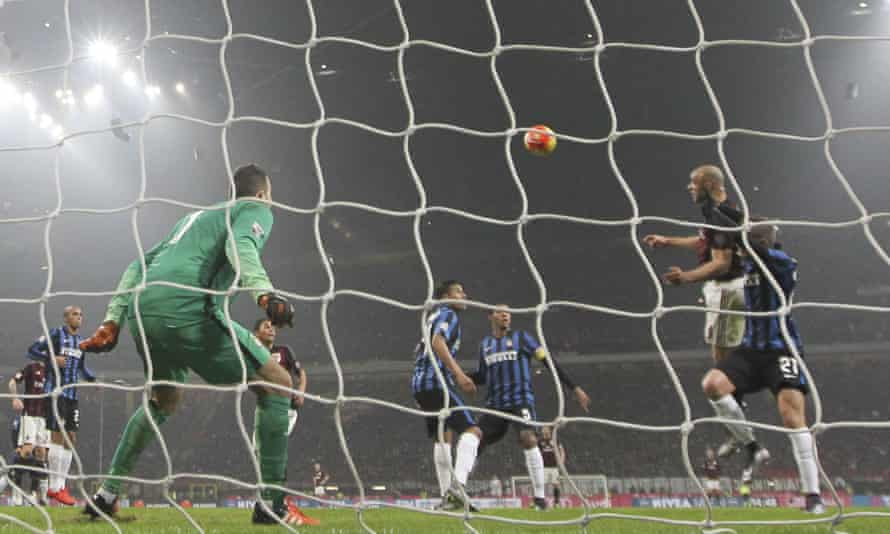 Milan's Alex climbs highest to head in the opening goal in their 3-0 derby victory over Inter.