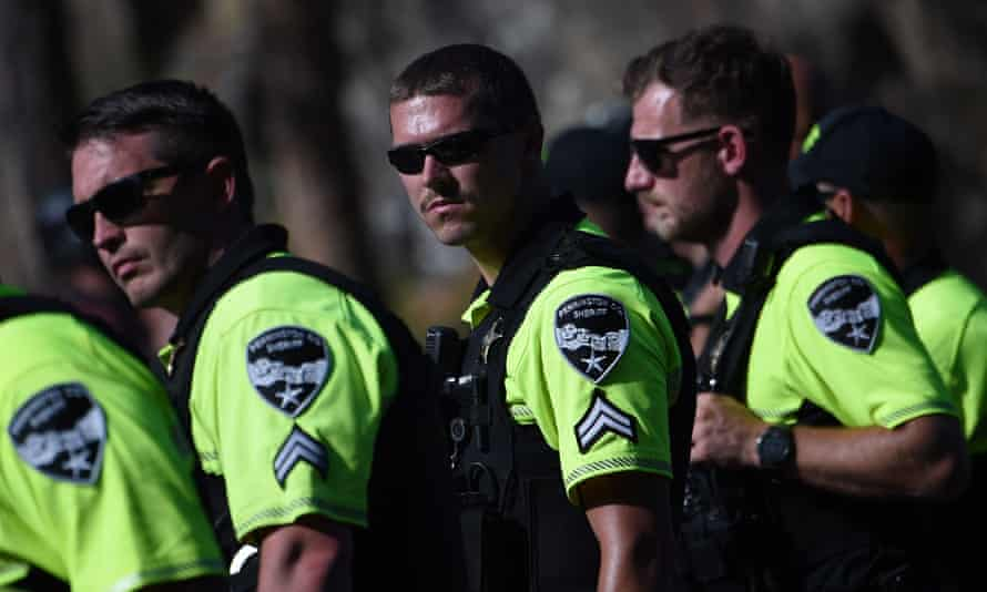 Sheriff's deputies look on as protesters block the road to Mount Rushmore National Monument in South Dakota.