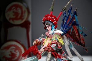 A Beijing Opera performer dances for a show by designer Hao Weimin at China fashion week