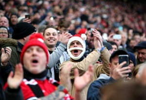 A fan wearing a santa hat during the Premier League match between Manchester United and Everton at Old Trafford.