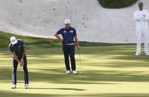 Sungjae Im watches as Dustin Johnson sinks his birdie putt on the thirteenth hole