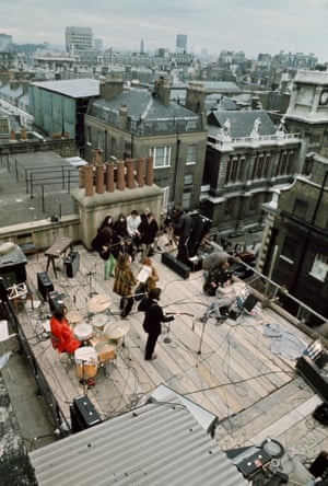 'I almost fell to my death' … the Beatles over Savile Row in 1969.