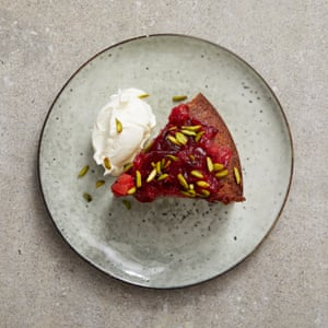 A dessert of plum and pistachio cake with rose water mascarpone.