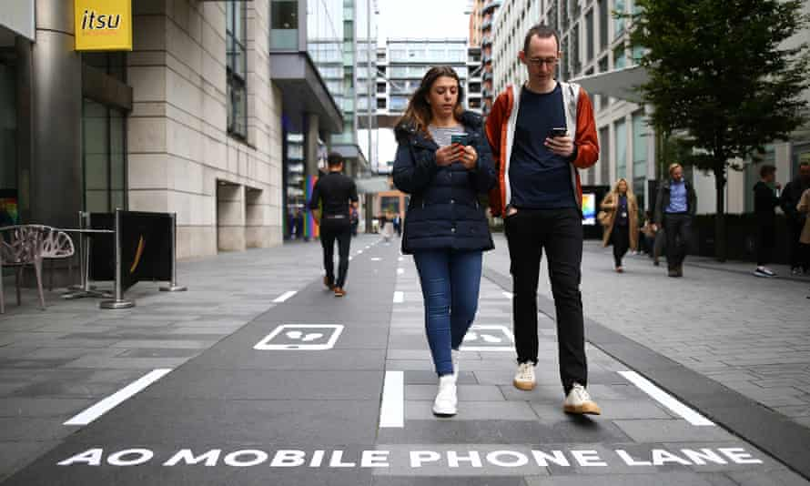 Various approaches have been tried to keep mobile users safe. Phone 'slow lanes' in Manchester.
