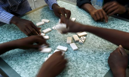 African migrants play a game of dominos at a bar in Marsa, on the outskirts of Valletta.